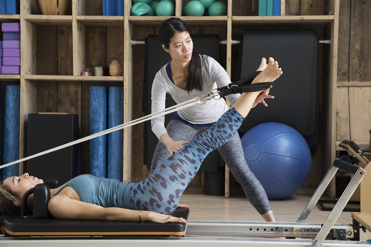Reformer Pilates: What it is, who it's best for and how to do some moves without the reformer